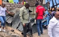 Gauteng Premier David Makhura surveys the damage in Alexandra following a fire in the area on 6 December 2018. Picture: @David_Makhura/Twitter