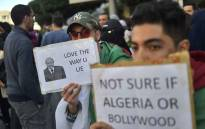FILE: Algerian students demonstrate in the centre of the capital Algiers on 12 March 2019, one day after President Abdelaziz Bouteflika announced his withdrawal from a bid to win another term in office and postponed an 18 April election, following weeks of protests against his candidacy. Picture: AFP
