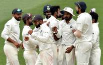 The Indian cricket team celebrates their victory in the first Test against Australia at the Adelaide Oval on 10 December 2018. Picture: AFP