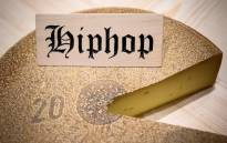 This picture taken on 14 March 2019 shows a round of cheese that has been matured for 6 month with hip-hop music, on the final day of an experiment conducted by the University of the Arts in Berthoud, in the Emmental region, central Switzerland. Picture: AFP.