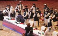 FILE: Members of the Taliban delegation leave their seats at the end of the session during the peace talks between the Afghan government and the Taliban in the Qatari capital Doha on 12 September 2020. Picture: AFP