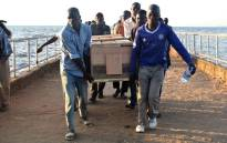 People carry a coffin on the banks of Lake Victoria as rescue workers search for victims on 22 September 2018, a day after the ferry MV Nyerere capsized. The death toll from a crowded ferry capsizing in Lake Victoria rose to more than 200 on 22 September, with scores of victims identified by grieving relatives, as rescuers found one lucky survivor from the disaster. Picture: AFP