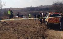 Police and paramedics inspecting the scene where two people were killed in a plane crash near the Lanseria Airport in Johannesburg. Picture: Thando Kubheka/EWN