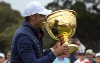 USA team member and captain Tiger Woods holds the Presidents Cup after their win over the International team following the golf tournament in Melbourne on 15 December 2019. Picture: AFP