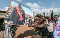 People celebrate with a portrait of former Ivory Coast president Laurent Gbagbo on 15 January 2019 in his birth-town Gagnoa after the news that International Criminal Court acquitted Gbagbo over a wave of post-electoral violence, in a stunning blow to the war crimes tribunal in The Hague. Picture: AFP