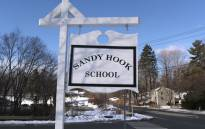 A sign stands near the site of the December 2012 Sandy Hook school shooting on the day of the National School Walkout on 14 March 2018 in Sandy Hook Connecticut. Picture: AFP