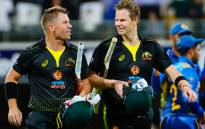 FILE: Australia's David Warner (L) speaks with Steve Smith after victory during the Twenty20 match between Australia and Sri Lanka at the Gabba in Brisbane on 30 October 2019. Picture: AFP