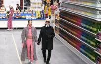 German fashion designer Karl Lagerfeld, flanked by British model Cara Delevingne  at the Chanel fashion show, on March 4. Picture:AFP.