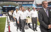 Family members of the late rugby legend Joost van der Westhuizen carry his coffin out of the Loftus Versfeld stadium in Pretoria following his official funeral service on 10 February 2017. Picture: Reinart Toerien/EWN