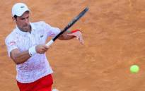 Serbia's Novak Djokovic plays a forehand to Norway's Casper Ruud during their semi final match of the Men's Italian Open at Foro Italico in Rome on 20 September 2020. Picture: @InteBNLdItalia/Twitter