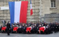 In this file photo taken on October 8, 2019 Police officers hold the coffins of their fallen colleagues during a ceremony at The Prefecture de Police de Paris (Paris Police Headquarters) in Paris, held to pay respects to the victims of an attack at the prefecture on October 4, 2019. Picture: AFP.