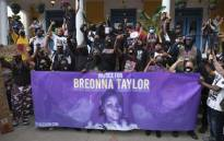 FILE: Demonstrators pose for a photo in front of a local restaurant in the NULU neighborhood on a third day of protest over the lack of criminal charges in the police killing of Breonna Taylor and the result of a grand jury inquiry, in Louisville, Kentucky, on 25 September 2020. Picture: AFP