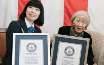 Kane Tanaka, right, receives a certificate after being recognised as the world's oldest person by the Guinness World Records. Picture: @GWR/Twitter.