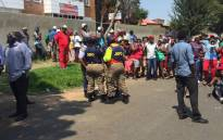 Turffontein residents protest in front of a foreign owned estate agency office. Picture: Pelane Phakgadi/EWN.