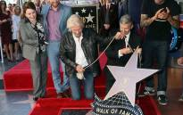 Sir Richard Branson (L) being honoured with a Star on the Hollywood Walk of Fame on 16 October 2018, in Hollywood, California. Picture: AFP