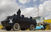 An Angola police armoured personnel carrier is seen blocking a street in Barrio do Camama, Luanda, on 6 April 2020 to enforce a lockdown order that has largely gone unnoticed in the daily grind and hustle on the capital's streets. Picture: AFP