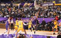 Cameron Payne #15 of the Phoenix Suns shoots the ball against the Los Angeles Lakers during Round 1, Game 6 of the 2021 NBA Playoffs on 3 June 2021 at STAPLES Center in Los Angeles, California. Copyright 2021 NBAE. Picture: Andrew D. Bernstein/NBAE/Getty Images via AFP