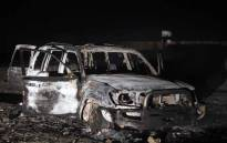 FILE: A picture taken on 2 November 2018, shows the remains of a car, reportedly used by the gunmen who attacked a bus carrying Coptic Christians, on the side of a road in Egypt's southern Minya province. Picture: AFP.