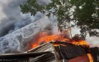 A City Power electricity pylon and its overhead lines have caved in on 5 March 2019, setting fire to multiple shacks in Stjwetla, in Alexandra. Picture: Supplied
