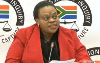 A YouTube screengrab shows North West Department of Safety and Transport CFO Kutlwano Phatudi at the state capture inquiry on 21 June 2019.