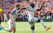 Liverpool's Adam Lallana and Sadio Mane celebrate a goal. Picture: AFP