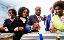 Former Zimbabwean president Robert Mugabe (C) his daughter Bona (C) and wife Grace cast their votes at a polling station at a primary school in the Highfield district of Harare during the country's general elections on July 30, 2018. Picture: AFP