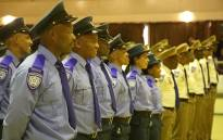 Traffic and Metro officials line up as they wait to graduate after 18 months of training. Picture: Bertram Malgas/EWN