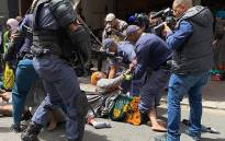 FILE: Foreign nationals were camping outside the UN Refugee Agency and asked for help to leave South Africa. Police clashed with the group on 30 October 2019. Picture: Kaylynn Palm/EWN.