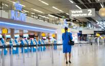 A KLM flight attendant walks in the Schiphol Airport, on January 21, 2021. Picture: Evert Elzinga/AFP.