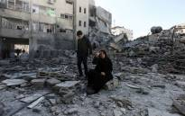 FILE: A picture was taken on 26 March 2019, shows a Palestinian woman sitting next to the rubble of a building in Gaza City after Israeli air strikes hit dozens of sites across the Strip overnight in response to rocket fire from the Palestinian enclave. Picture: AFP