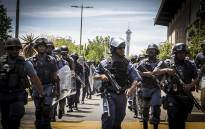 Members of the Saps patrol around Wits University's main campus on 11 October 2016 during protests over tertiary education fees. Picture: Reinart Toerien/EWN.