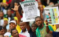 South African supporters hold a portrait of murdered Bafana Bafana captain and goalkeeper Senzo Meyiwa during the Africa Cup of Nations 2015 qualifying football match South Africa vs Sudan, at the Moses Mabhida Stadium in Durban, on 15 November, 2014. Picture: AFP