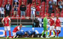 Medics attend to Denmark's midfielder Christian Eriksen after he collapsed during the UEFA EURO 2020 Group B football match between Denmark and Finland at the Parken Stadium in Copenhagen on 12 June 2021. Picture: Jonathan Nackstrand/AFP