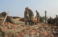 Nepali soldiers carry out belongings from a damaged home in Nepal's southern Bara district near Birgunj on 1 April 2019, the morning after a rare spring storm. Picture: AFP.