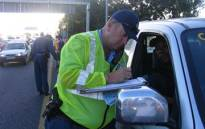 FILE: A traffic officer issues a fine during a blitz on Cape Town's N2 highway. Picture: EWN