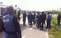 Vrygrond taxi drivers face off with police on 16 September, 2014, with many of them upset that their taxis have been impounded. Picture: Siyabonga Sesant/EWN.. Picture: Siyabonga Sesant/EWN.