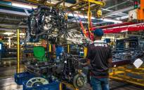 Workers on a vehicle assembly line. Picture: @FordSouthAfrica/Twitter