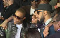 Chris Brown poses for pictures with musicians Ludacris and Swizz Beats. Picture: Supplied.