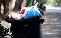 Rubbish piles up on Louis Botha Avenue due to the ongoing strike action by Piki Tup. Picture: EWN