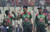 FILE: Bangladeshi cricketer Mustafizur Rahman (C) celebrates with teammates after the dismissal of the West Indies cricketer Devendra Bishoo during the first One Day International (ODI) between Bangladesh and West Indies at the Sher-e-Bangla National Cricket Stadium in Dhaka on 9 December 2018. Picture: AFP.