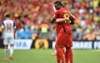 Belgian forward Divock Origi celebrates with midfielder Kevin De Bruyne during the 2014 Fifa World Cup. Picture: AFP.