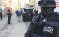 In this handout picture released by the Austrian interior ministry, Austrian policemen stand guard a street near a mosque in Vienna on 6 November 2020, after the Austrian government ordered its closure in the wake of the deadly jihadist shooting four days earlier. Picture: AFP