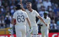 South Africa's Dwaine Pretorius (right) gestures after the dismissal of England's Jos Buttler during the first day of the second Test match between South Africa and England at the Newlands stadium in Cape Town. Credit: MARCO LONGARI, AFP
