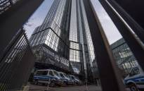 Police vehicles are parked at Deutsche Bank's headquarters in Frankfurt on 29 November 2018. German prosecutors raided several Deutsche Bank offices in the Frankfurt area over suspicions of money laundering based on revelations from the 2016 'Panama Papers' data leak. Picture: AFP