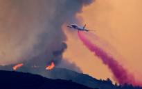 A 747 Global Supertanker jet drops fire retardant at the Holy Fire near Lake Elsinore, in Orange County, California, on 7 August 2018. Picture: AFP.