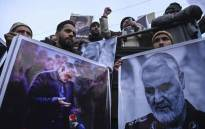 Protesters shout slogans against the United States and Israel as they hold posters with the image of top Iranian commander Qasem Soleimani, who was killed in a US airstrike in Iraq, and Iranian President Hassan Rouhani during a demonstration in the Kashmiri town of Magam on 3 January 2020. Picture: AFP.