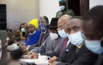 FILE: Former Nigerian president Goodluck Jonathan (C), wearing a face mask, prepares for a meeting between Malian military leaders and an Ecowas delegation headed by former Nigerian president on 22 August 2020, in an aim to restore order after the military coup in Bamako. Picture: AFP
