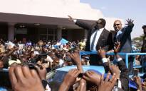 Malawis newly elected President, Professor Peter Mutharika (2nd R), a young brother of the former late President Bingu wa Mutharika, and his Deputy Saulos Chilima (R) greet supporters after taking an oath of office at the High Court on 31 May, 2014, in Blantyre, Malawi. Picture: AFP.