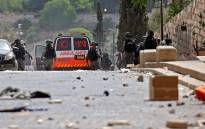 Palestinians clash with Israeli security forces in Jerusalem's Old City on 10 May 2021, ahead of a planned march to commemorate Israel's takeover of Jerusalem in the 1967 Six-Day War. Picture: Emmanuel Dunand/AFP.