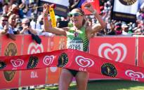 South African long distance runner Charne Bosman crosses the line to win the women's race of the Comrades Marathon on 29 May 2016 in Durban. Picture: AFP.